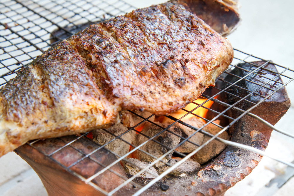Fish cooking over charcoal. The best and simplest way to cook a fish.