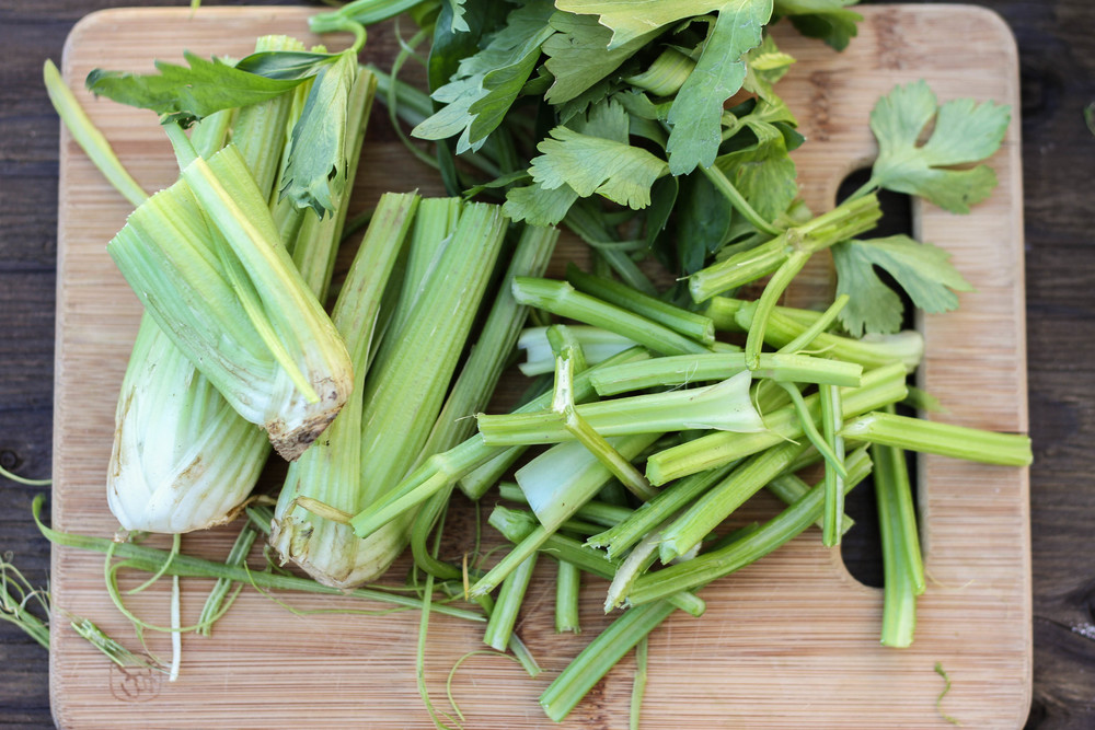 Chinese celery. Separate the stalks from the leaves. The leaves cook up much faster than the stalks.