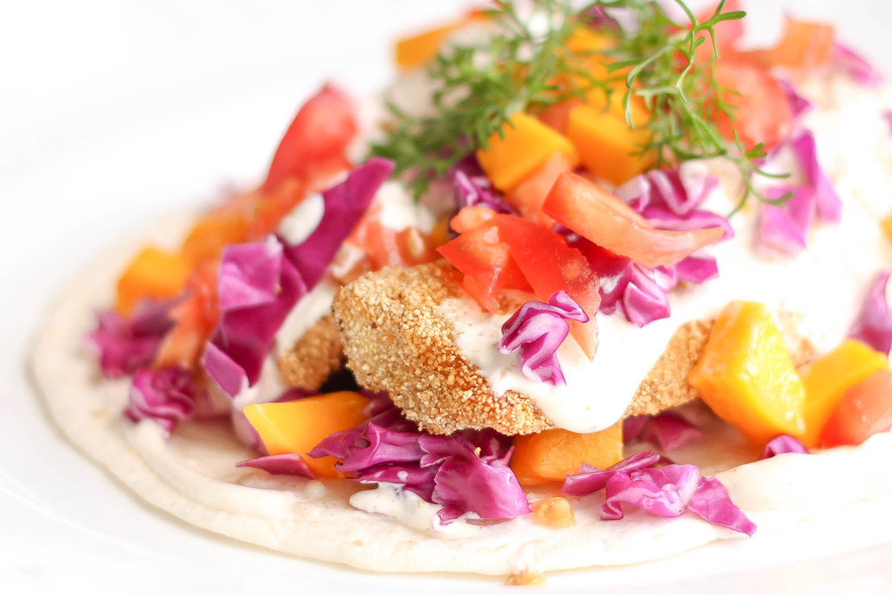 Hawaiian Fish Tacos with Red Cabbage, Mango, Tomatoes, Cilantro and Sour Cream Sauce