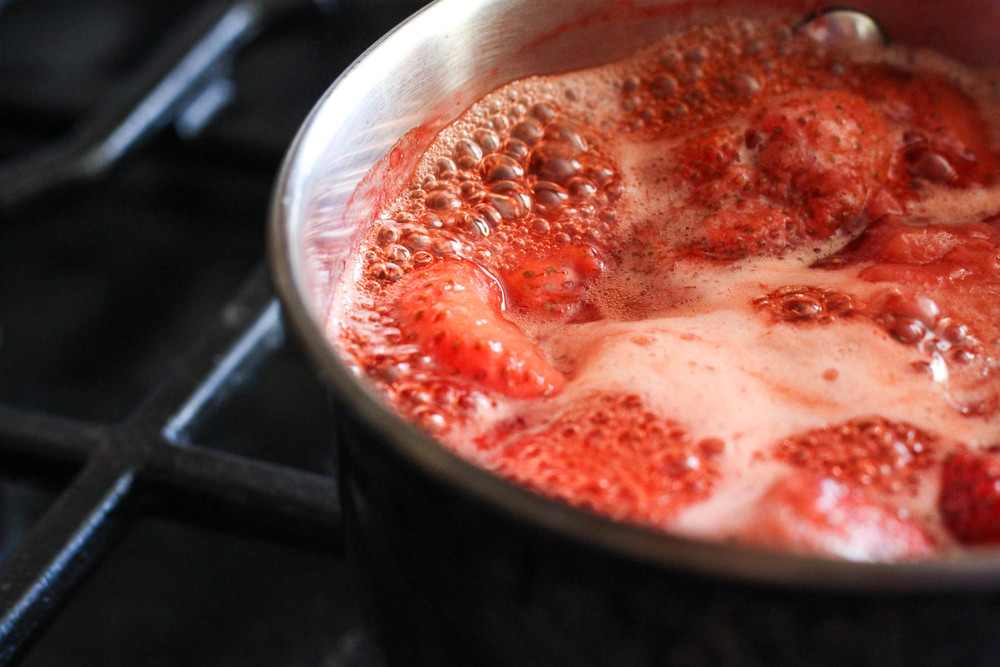 Cook down fresh strawberries to make strawberry puree