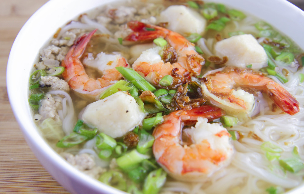 Vietnamese Pork & Seafood Noodle Soup (Hu Tieu) with fish balls, ground pork, shrimp, fried shallots and green onions.