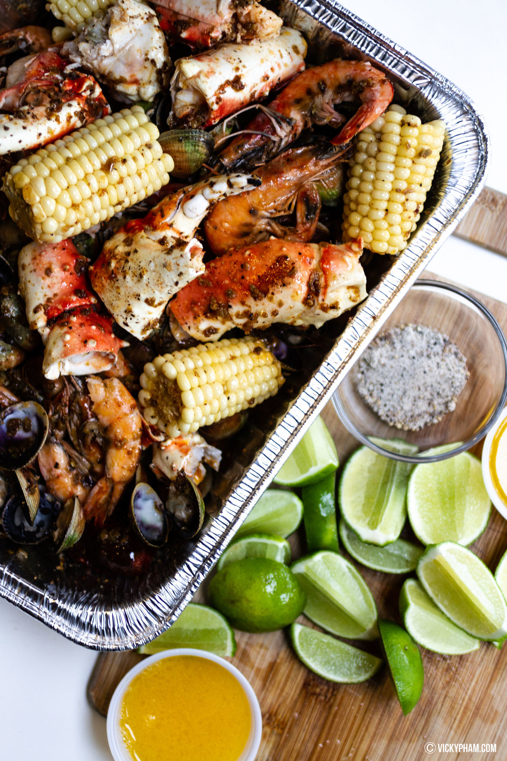 Vicky's awesome seafood boil: King crab legs, clams, shrimp, corn and sausage in a fiery and buttery garlic lemon pepper sauce