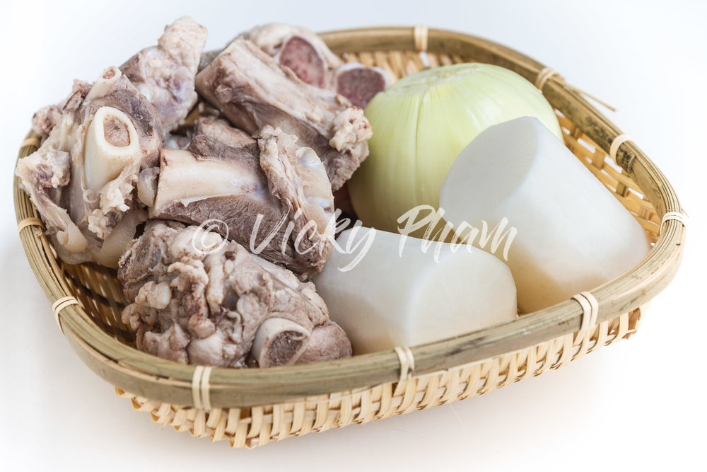 Ingredients for a basic Vietnamese pork stock: pork bones, daikon and onion