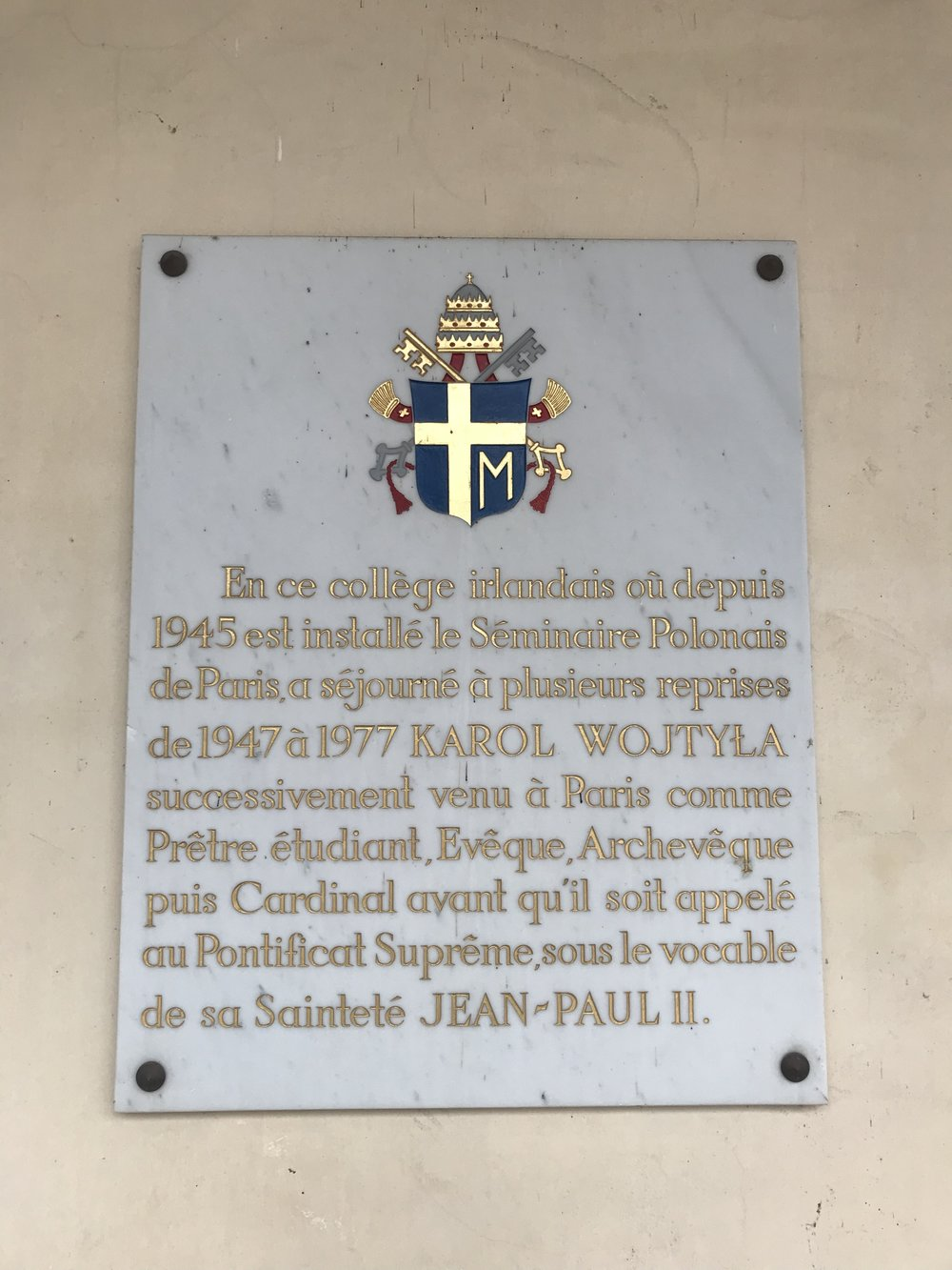 A commemorative plague in the college's court about the Polish Seminary in Parias and visits of Karol Wojtyla