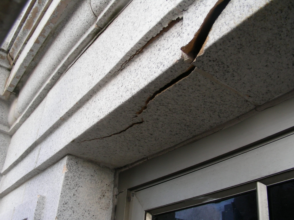 Structural damage to exterior of building prior to facade restoration project