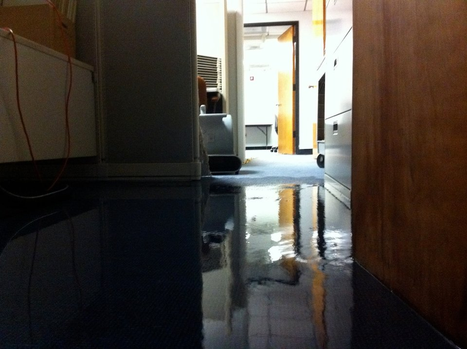 Water floods interior of carpeted office space