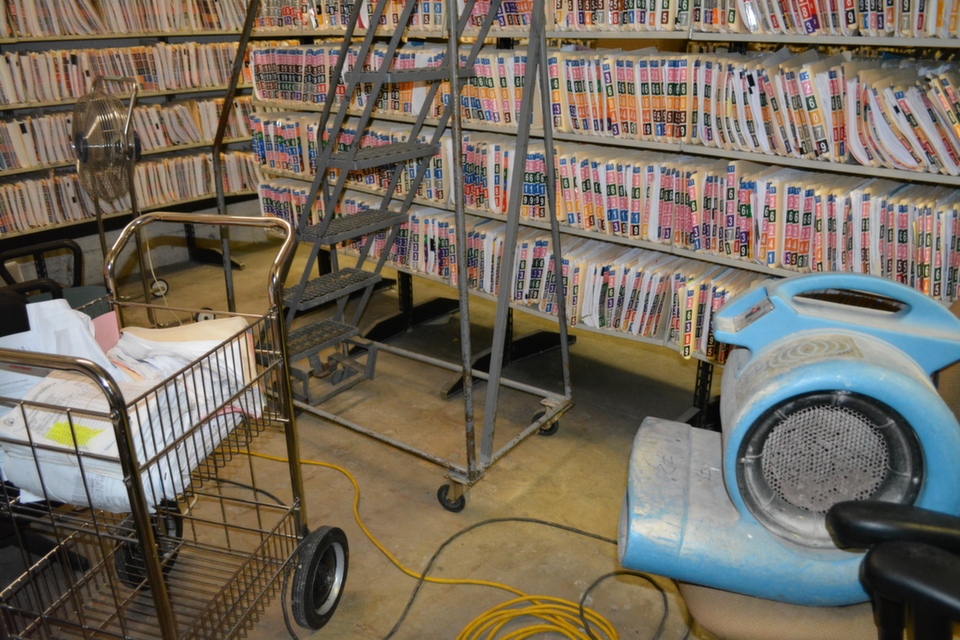 Files in basement file room must routinely be dried with high-speed blower due to water damage