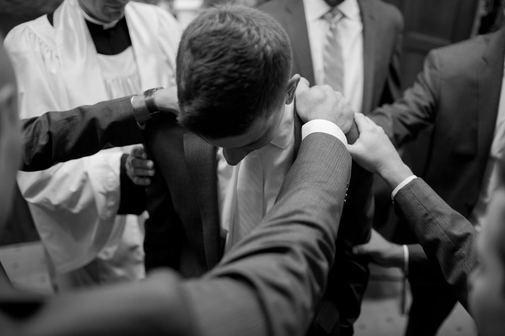 Christian-wedding-praying-over-groom