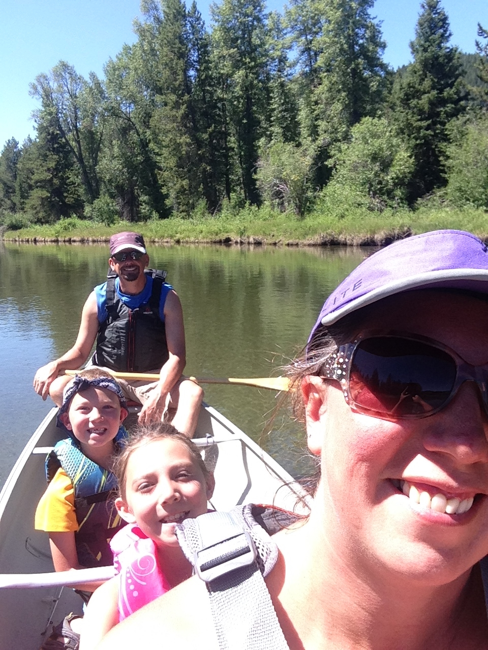 Summer Vacation: Recently, my family camped in Colter Bay Campground in Grand Teton National Park. Pictured here on the Snake River near Oxbow Bend (front to back) is Alicia, my wife; Emily, Wyatt and myself.