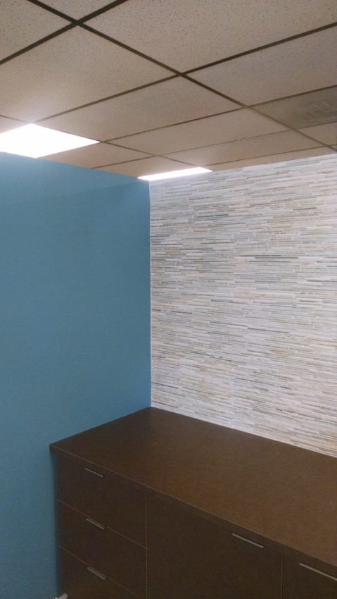 View of receptionist area: paint and tile