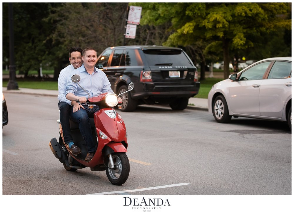 same sex couple on scooter
