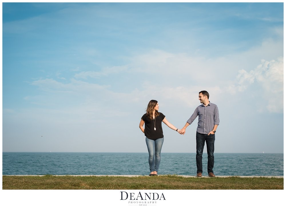 couple with lake in background looking at each other