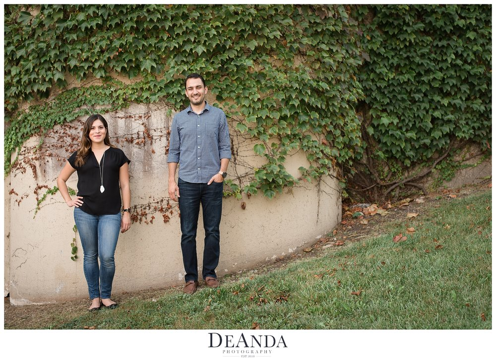 couple in front of ivy wall
