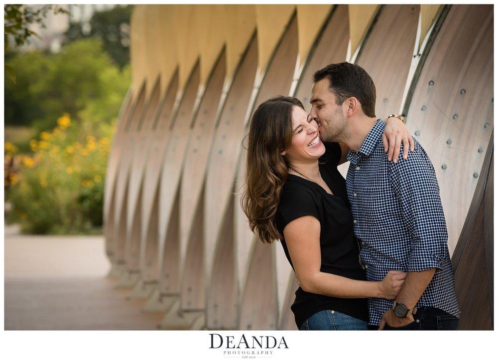 couple kissing at honeycomb