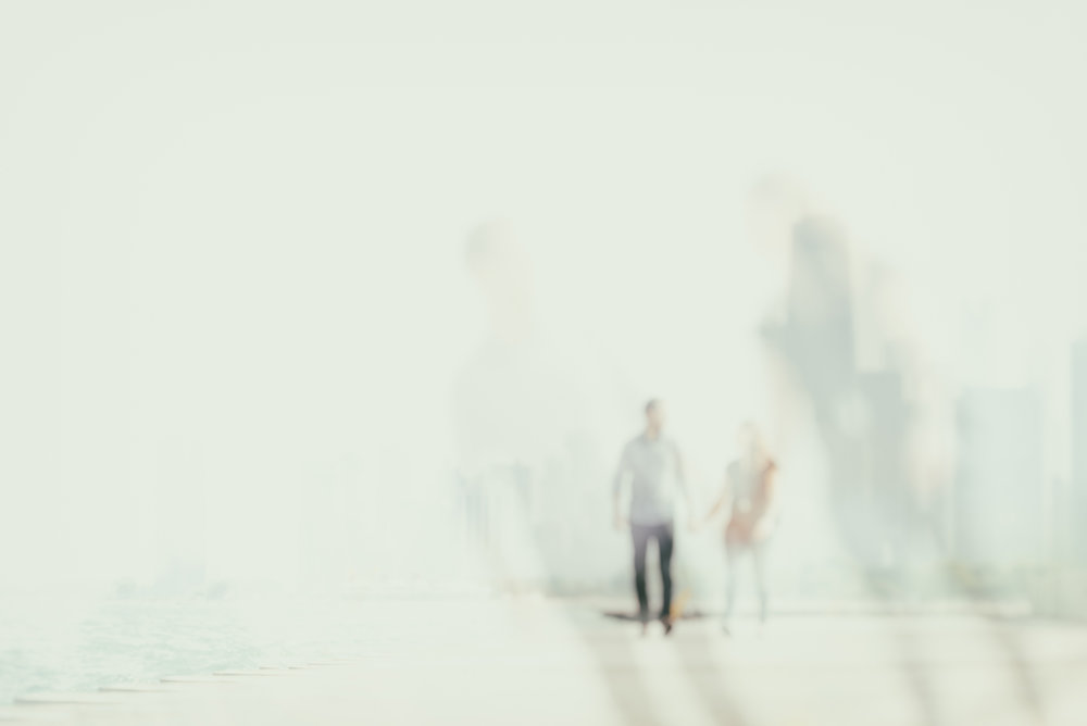 abstract couple in chicago walking along Lake Michigan