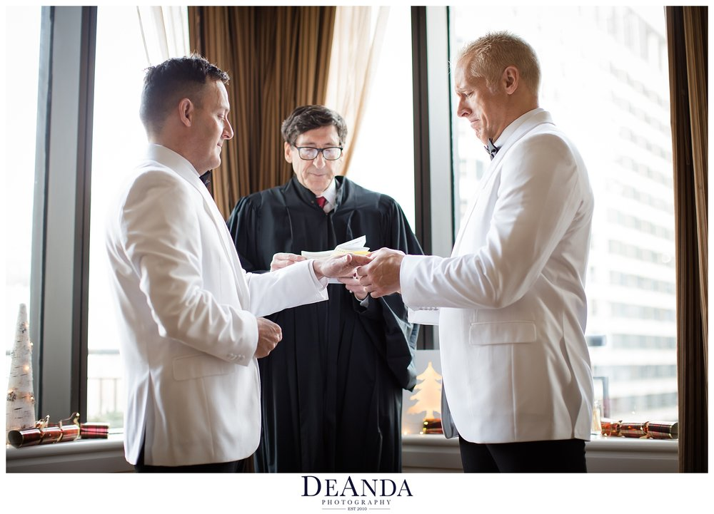 grooms exchanging rings