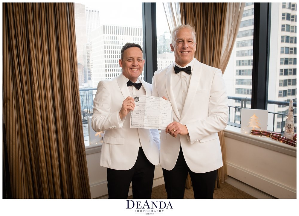 chicago grooms holding marriage certificate