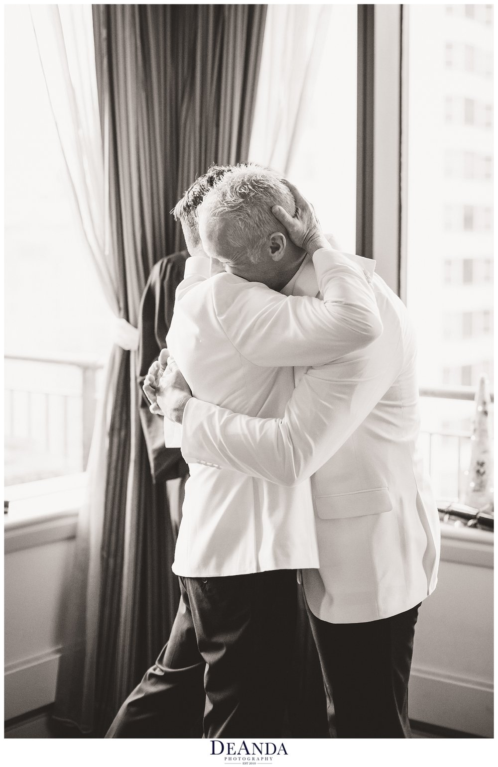 grooms embrace after being wed