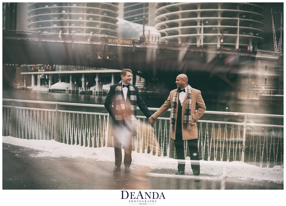 artistic wedding image of two grooms on chicago riverwalk