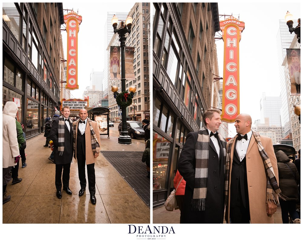 two grooms in front of the chicago theatre sign