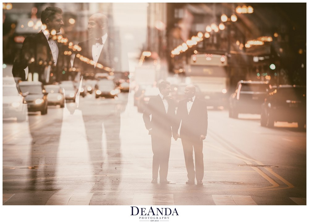 artistic image of two grooms on street in chicago on wedding day