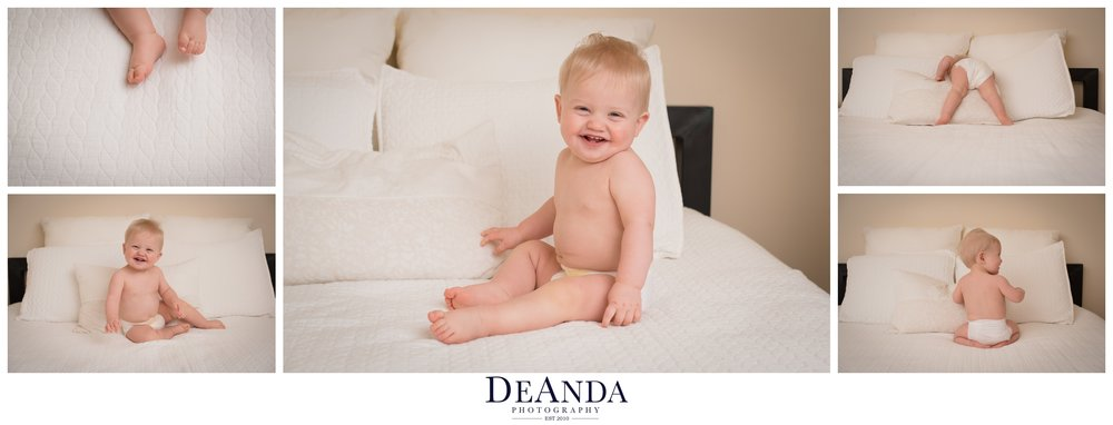 1 year old lifestyle portraits in home on bed in diaper