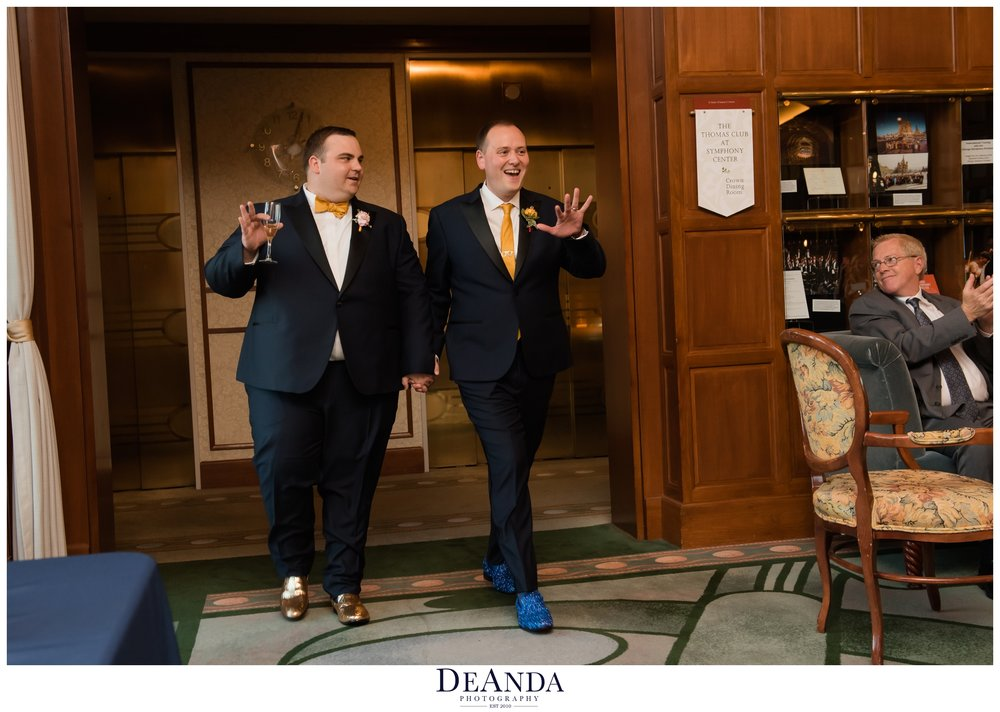 two grooms entering their reception in chicago