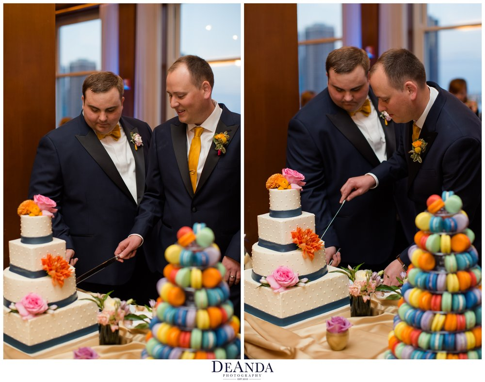 grooms cutting the cake at their weddin
