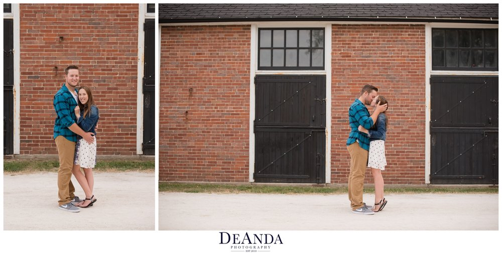 st.james farm engagement photos in front of stables