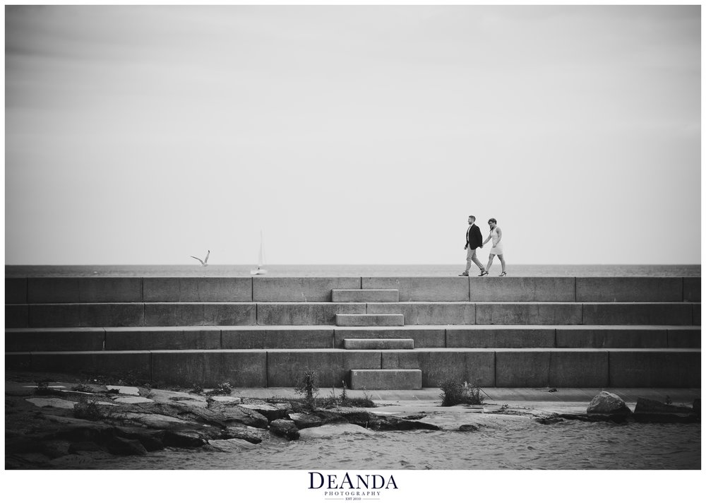 chicago engaged couple walking on 12th street beach pier