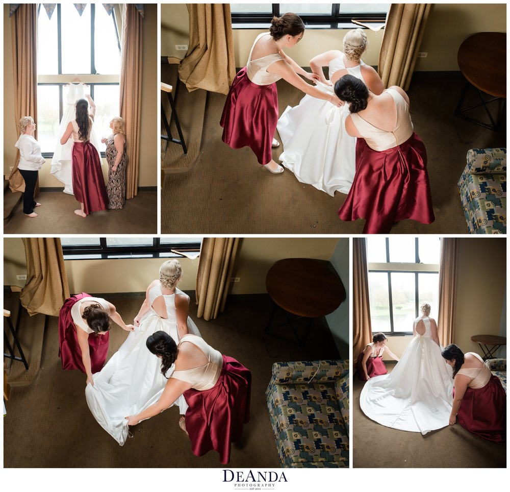 bride putting on wedding dress at Pheasant Run Resort in St.Charles Illinois