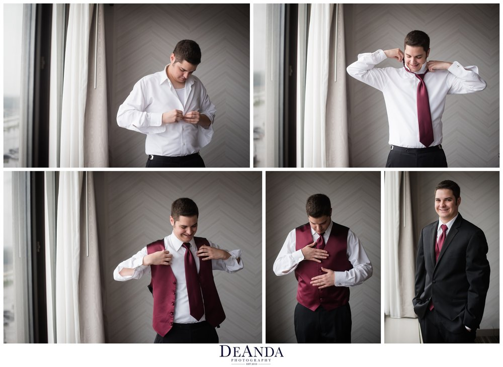 groom getting dressed at Pheasant Run Resort in St.Charles Illinois