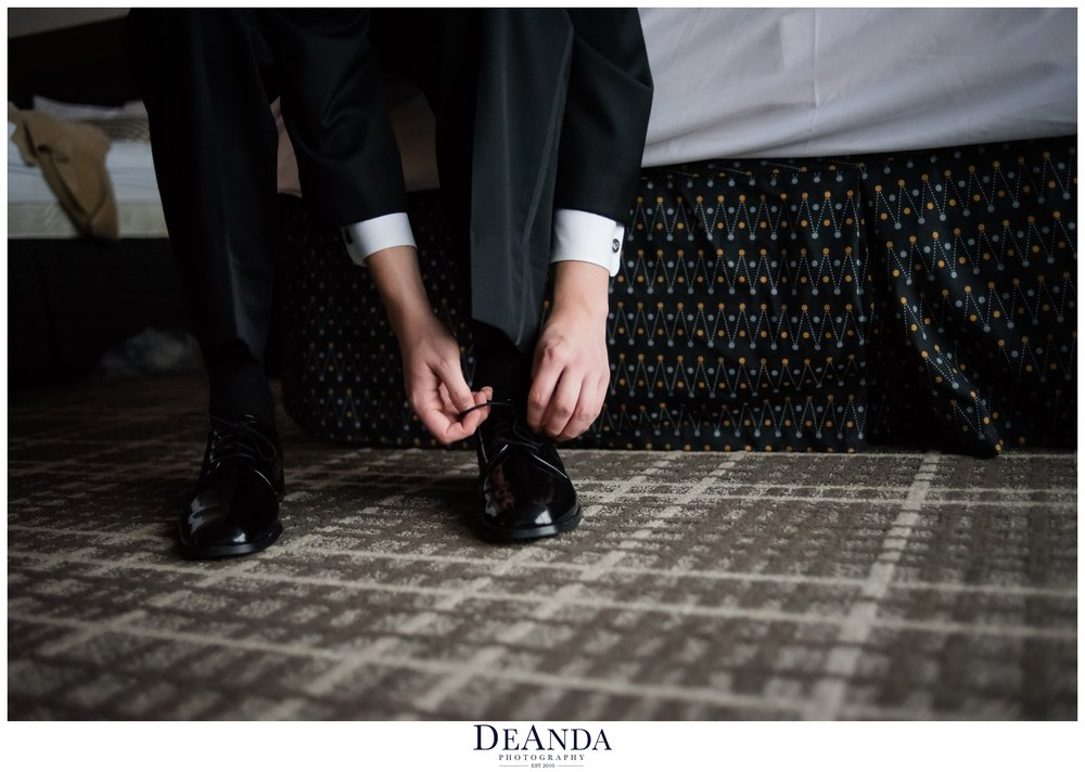 groom getting ready at Pheasant Run Resort in St.Charles Illinois