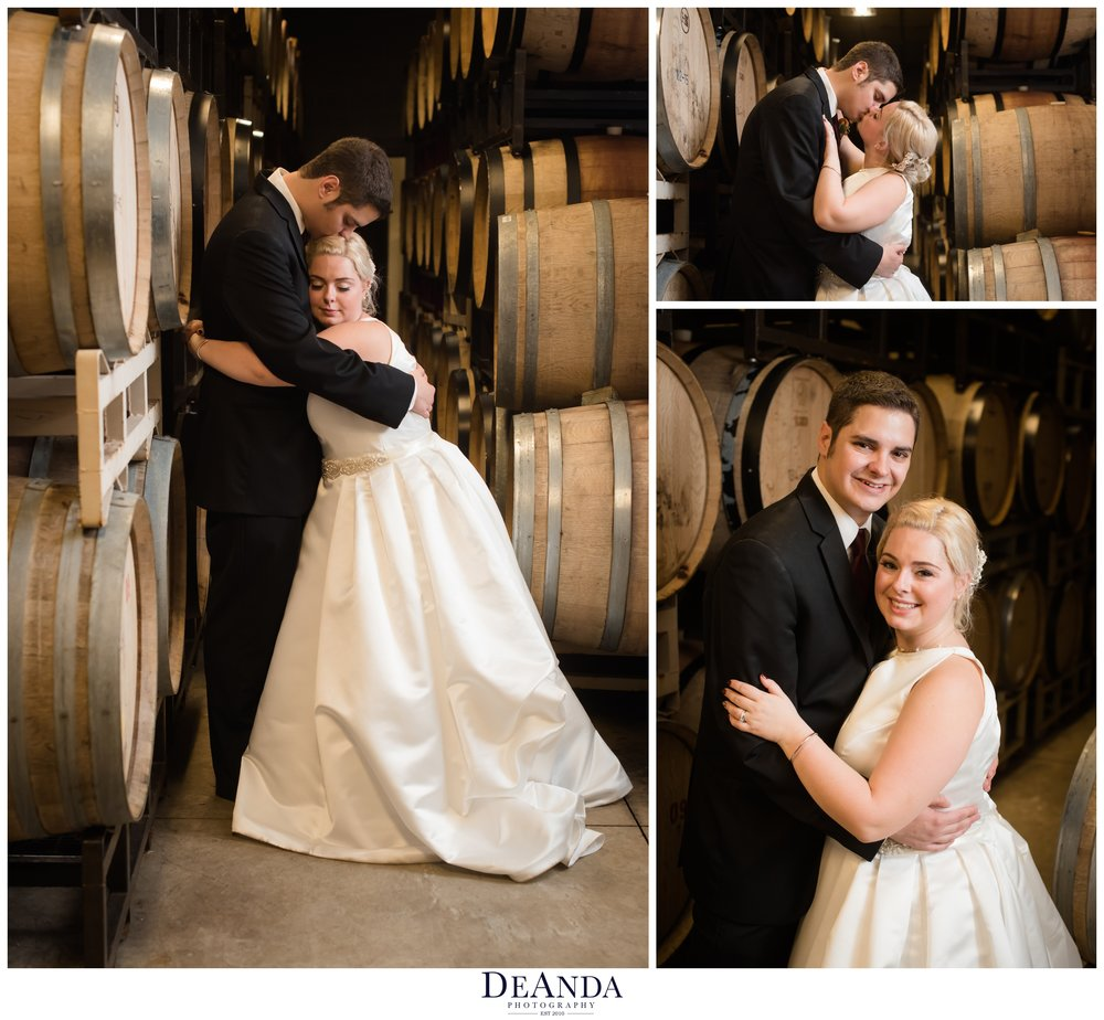 bride and groom in barrel room at acquaviva winery in maple park