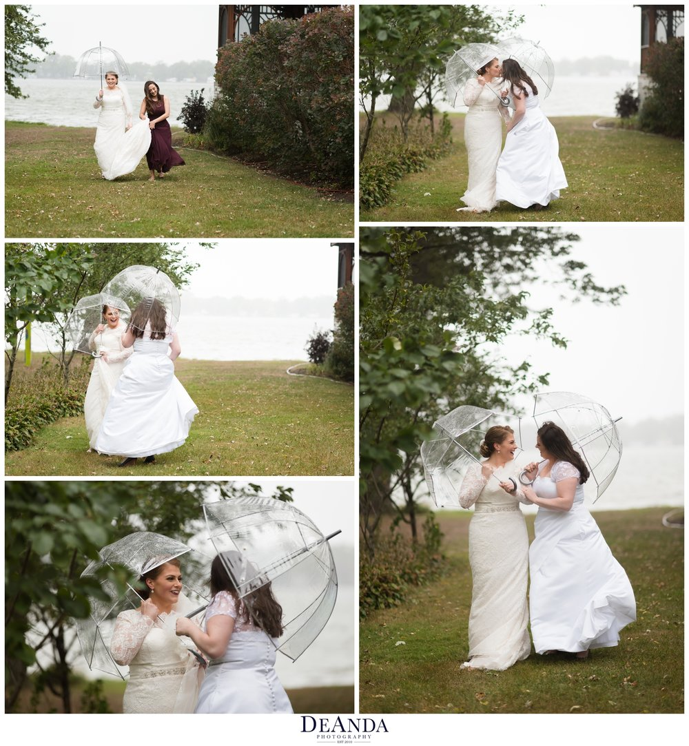 rainy first look in front of lake with umbrellas