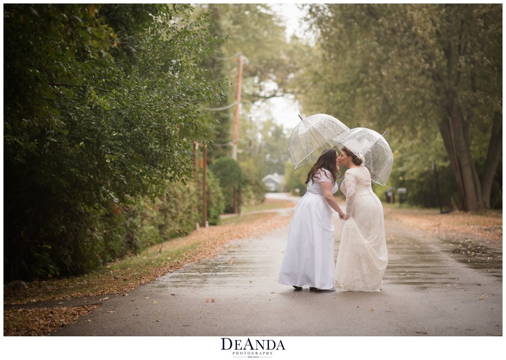 beautiful brides portrait of same sex couple under umbrellas