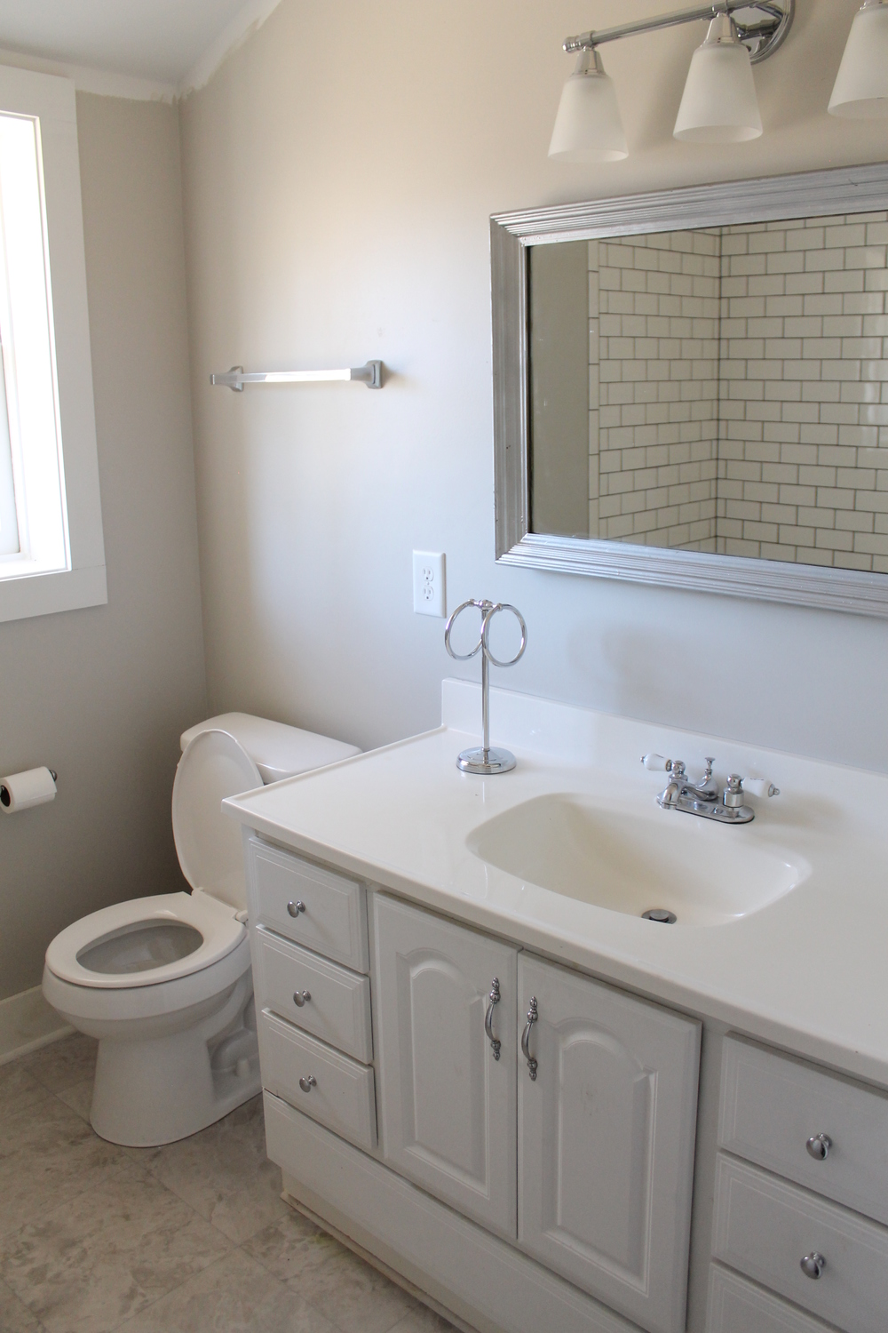 Elizabeth Burns Design | Bathroom Renovation on a Budget - diy subway tile, craigslist vanity, SW Agreeable Gray, vinyl flooring