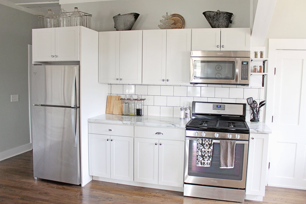 Elizabeth Burns Design | Budget Farmhouse Kitchen Renovation Fixer Upper - white shaker cabinets, formica marble laminate counter, subway tile, sherwin williams silver strand