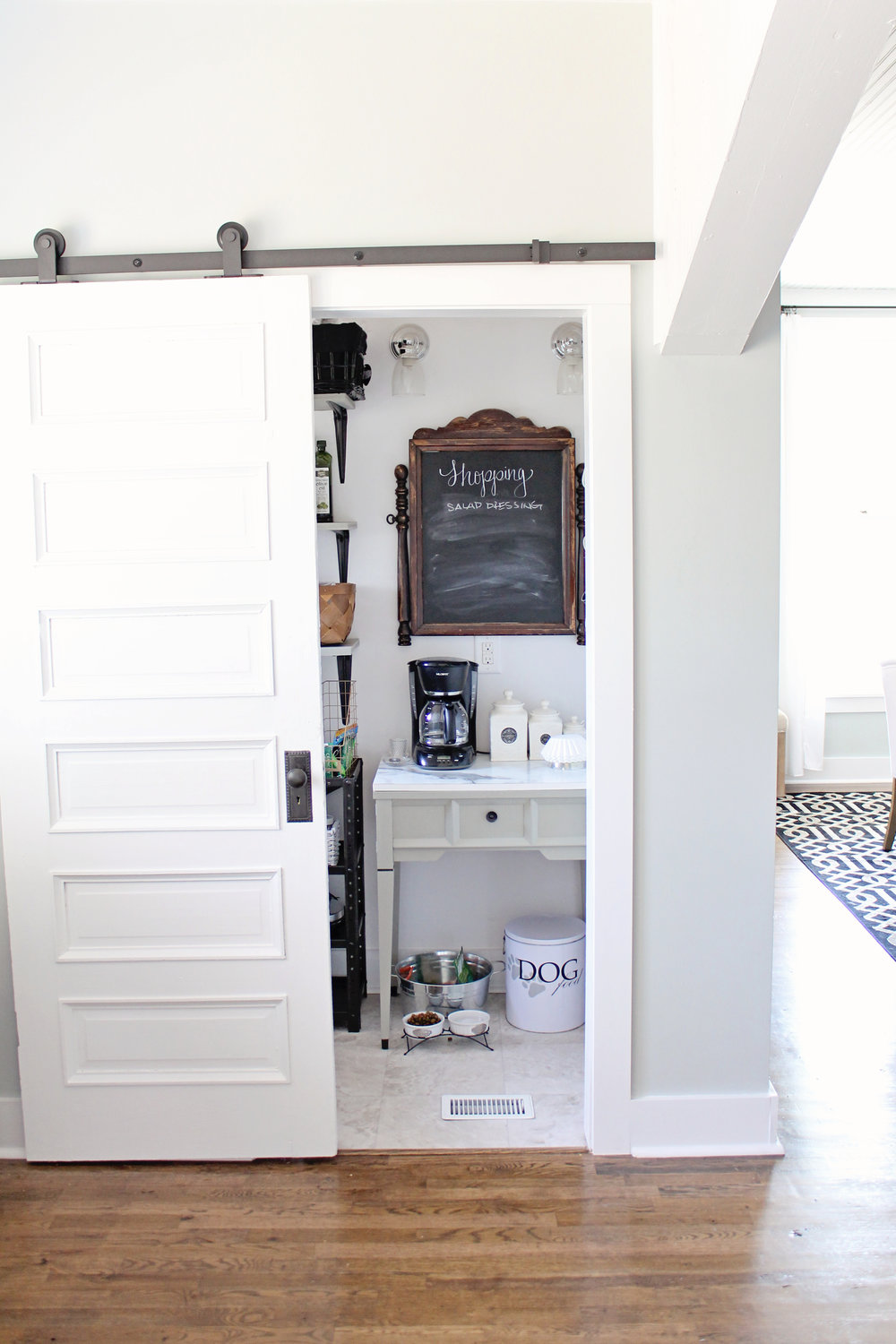 Elizabeth Burns Design | Budget Farmhouse Kitchen Renovation Fixer Upper - white shaker cabinets, formica marble laminate counter, subway tile, sherwin williams silver strand, barn door
