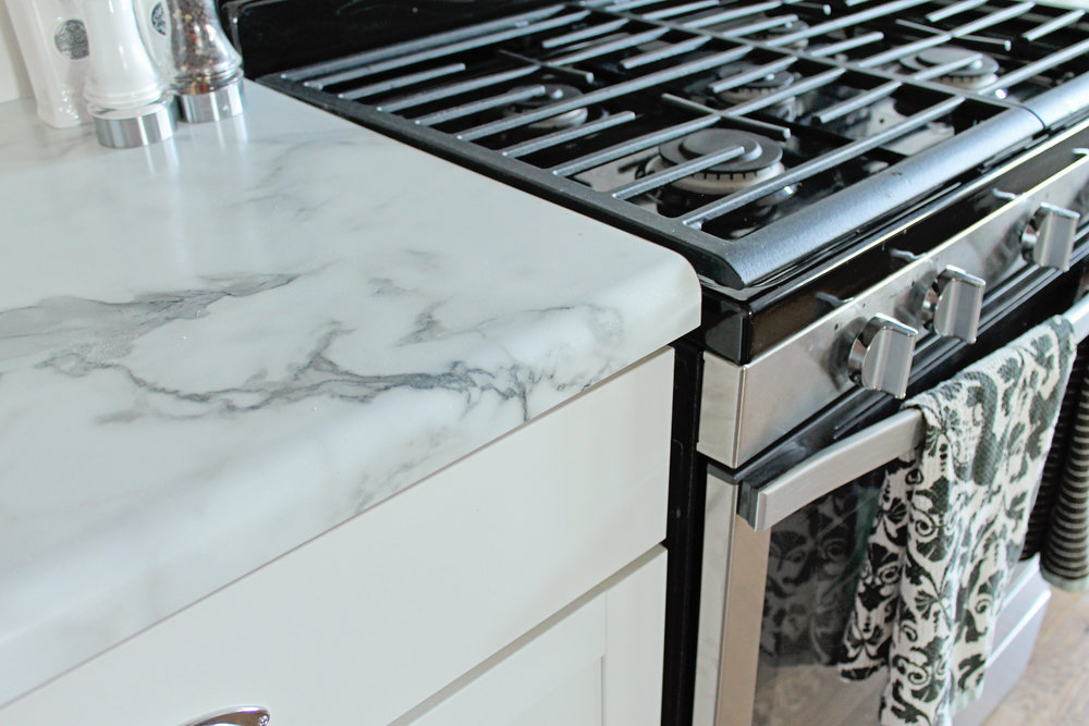 White Kitchen Cabinets With Calcutta Marble Formica