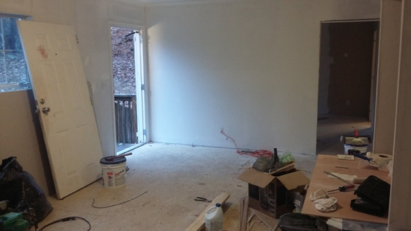 Elizabeth Burns Design | How to Flip Houses - living room after with drywall installed
