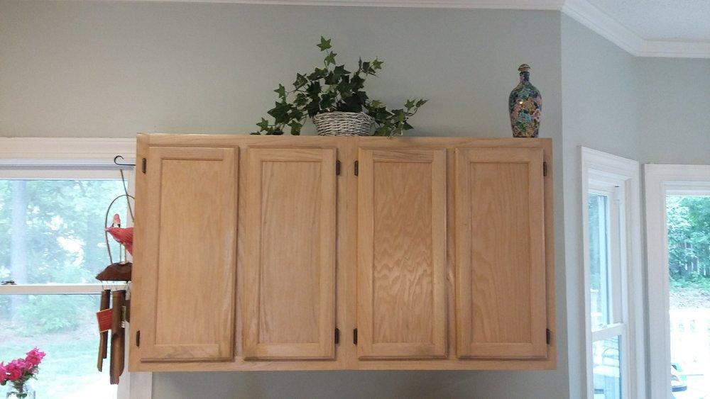 Elizabeth Burns Design | Raleigh Interior Designer - builder grade oak cabinets budget kitchen renovation, painting oak cabinets before and after