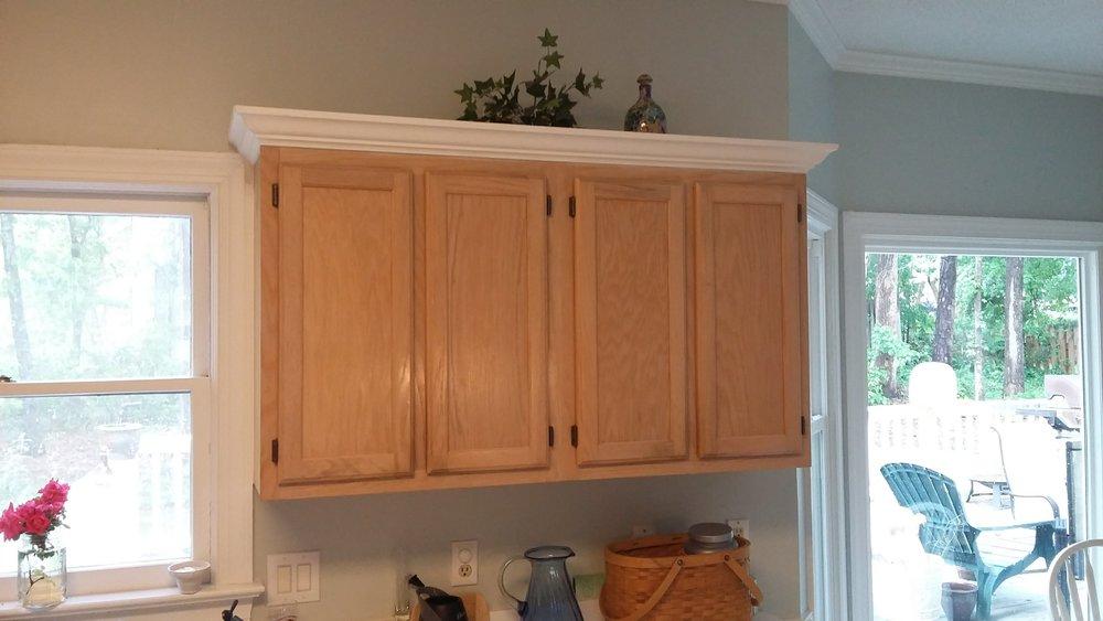 Elizabeth Burns Design | Raleigh Interior Designer - builder grade oak cabinets budget kitchen renovation, painting oak cabinets with crown molding