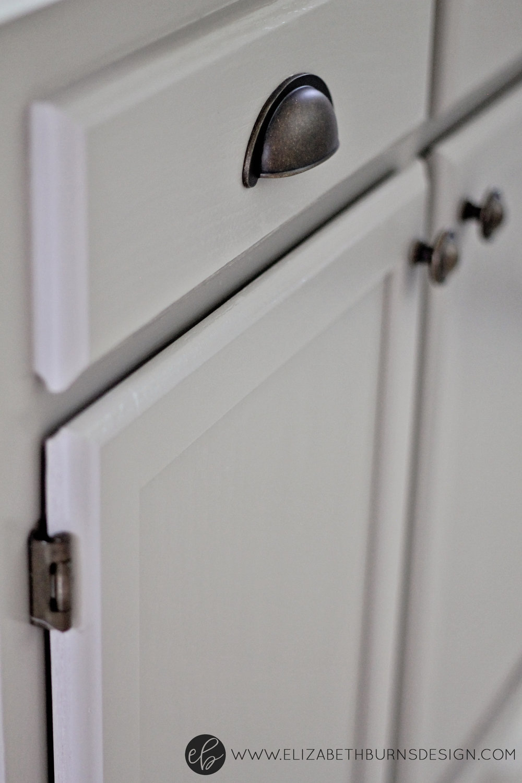 Elizabeth Burns Design | Raleigh Interior Designer - Sherwin Williams Function Gray Cabinet; hardware to match brass hinges on kitchen cabinets 1
