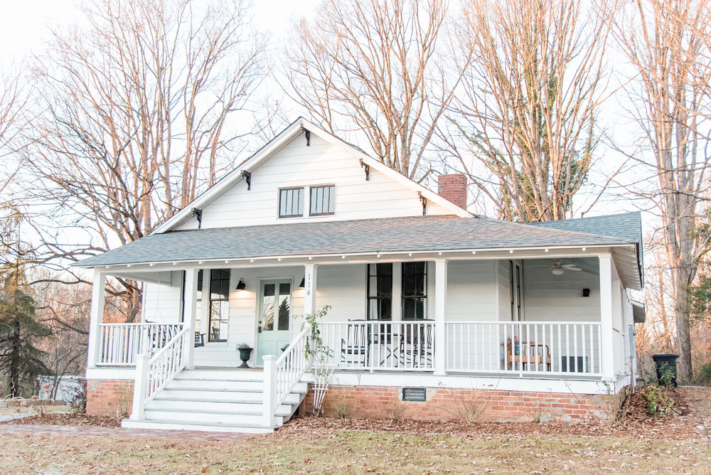 Elizabeth Burns Design | Farmhouse Renovation - white siding black windows, wraparound front porch