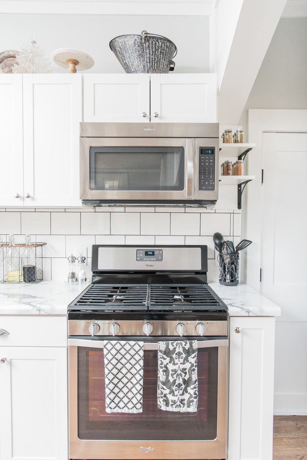 Elizabeth Burns Design | Farmhouse DIY renovation, budget kitchen renovation with formica counters and white shaker cabinets
