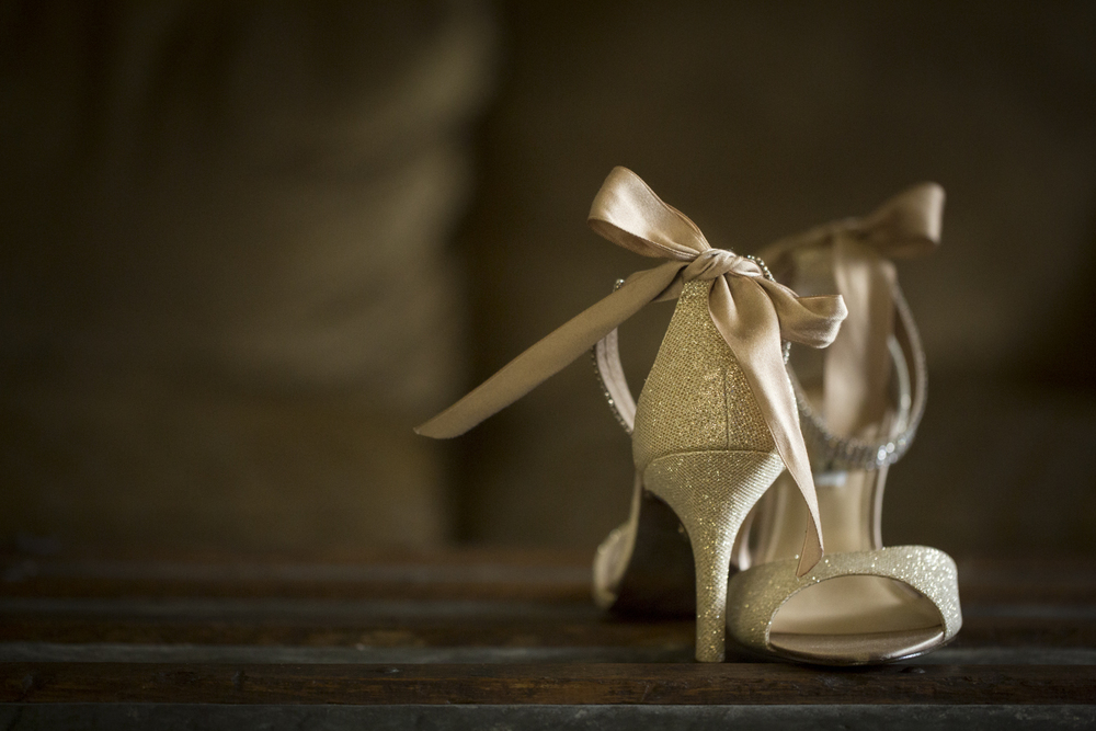 gold bow wedding shoes beach wedding photographer
