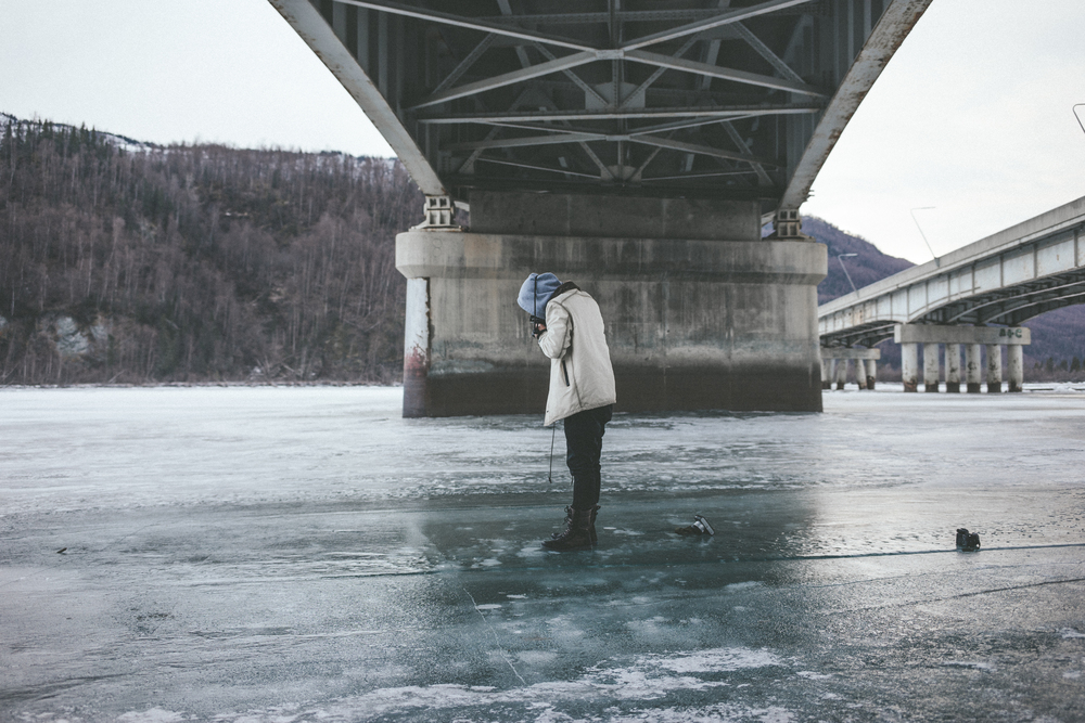 Nikk scatters out his collection of Leica's all around him on the frozen river. NBD.