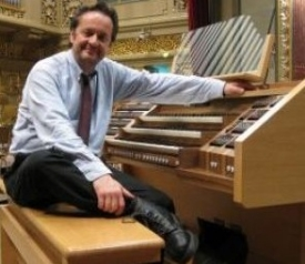 Maestro Radu at the console of the grand organ of the Bucharest Philharmonic Hall