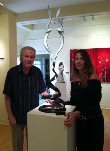 "Tom Bennett and daughter Terrie Bennett with newly unveiled ""Awakening"" by Terrie"